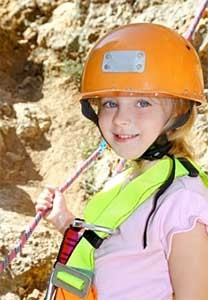 Little girl with climbing helmet